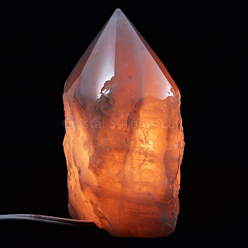 Rose Quartz Crystal Lamp with rough texture and polished pointed top